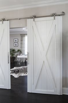 Salvaged and re-purposed barn doors #zebra #white #home #homedecor #design #decorating #animalprint