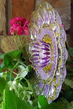 GARDEN YARD ART:  suncatcher made with recycled glass painted violet and yellow for outdoors