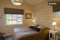Chambre à coucher dans un chalet en bois KONTIO.  http://www.kontio.fr/