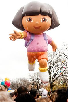 21. It's Thanksgiving and Mom and daughter are visiting relatives in New York.  They decide to take in the Macy's Thanksgiving parade. To the little girl's delight a giant float appears representing her favorite explorer.