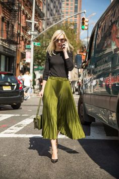 A full pleated skirt paired with a black knit top. A full pleated skirt paired with a black knit top. Mode Outfits, Fashion Outfits, Womens Fashion, Fashion Trends, 30 Outfits, Skirt Fashion, Modest Fashion, Fashion Clothes, Stylish Outfits
