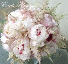Bride's Bouquet of peonies and astilbe with a smidge of rasberry ranunculus
