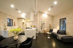 Dark stained concrete floors with cream and white walls!