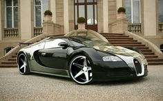 Bugatti Veyron. Am I the ONLY one who actually thinks the Bugatti is NOT ugly?!?!?!