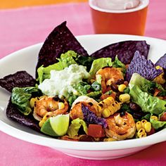 Southwestern-Style Shrimp Taco Salad  228 calories!  Cilantro, chipotle hot sauce, corn, black beans, and green onion lend fantastic south-of-the-border flavor to this shrimp-topped taco salad.