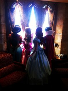 Snow White, Ariel, Aurora and Jasmine looking out of a window in the Cinderella Suite in Magic Kingdom Disney World. Been there. :)