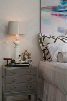 Like the gray laquered side table and the art above the bed.  And the white lampshade.