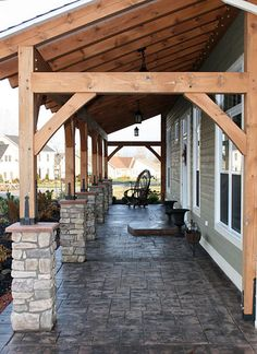 The covered porch of this Oregon home package from Linwood Homes shows as much attention to detail as you'll see inside the house. Cedar posts, stone pillars and a beautiful patio floor create an inviting space and add home value through amazing curb appe