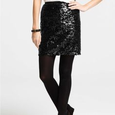 """Sequin and tulle mini skirt A dazzling sequined overlay adds glitz and glamour to this scene-stealing skirt, perfect for any holiday occasion. Hidden back zipper with hook-and-eye closure. 19"""" from natural waist. NWOT.  I bought this as a back up for New Year's but decided on another dress. I have no occasion now, but this skirt deserves to be worn by you! Ann Taylor Skirts Mini"""