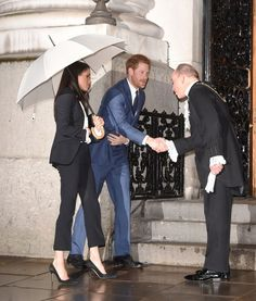 Meghan and Harry being greeted on their arrival