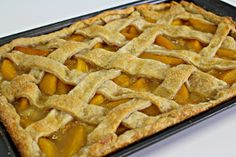 Better Than Anything Peach Slab Pie is the perfect dessert to feed a crowd. This easy peach pie may not be the prettiest dessert in the world, but everyone will love the pie's rustic charm. Plus, this peach pie recipe is made entirely from scratch. This recipe will also show you how to make peach pie filling year round because it uses frozen peaches.If you're feeling fancy, you can top the pie with a lattice crust, but a plain double crust would be just as delicious.