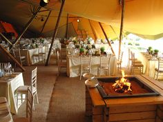 Tipis styled for formal wedding reception dining