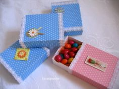 fabric or paper covered matchboxes with embellishments...sweet candy favor or for small items. Might use this for the ladies at the mail swap for tiny stickers, etc.