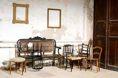 Napoleon III chairs awaiting repairs on a rainy day.