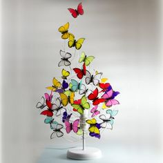 PROPERTIES: Table lamp made of iron white color base, silver aluminum wire, and white and multicolor butterflies made of french tracing paper. LOOK & FEEL: Our papers, imported. Butterfly Table, Butterfly Gifts, Red Butterfly, Butterfly Design, Table Flowers, Unique Lighting, Nature Decor, Kids Decor, Decoration