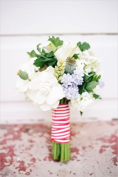 Red, white, and blue bouquet. #weddingchicks #redwhiteandblue Floral Design: Rosebud Floral Design http://www.weddingchicks.com/2014/06/17/patriotic-summer-lovin-wedding/