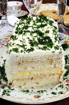 """The Sandwich Loaf. One would be tuna salad, another egg salad, and the other ham salad. The """"frosting"""" is cream cheese thinned with mayo. Tee Sandwiches, Tea Party Sandwiches, Appetizer Sandwiches, Appetizers, Retro Party, Retro Recipes, Vintage Recipes, Fingers Food, Tapas"""