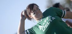 Senior Leslie Brown hurls a softball for Kappa Delta during the Greek Olympics. - Photo by Kathleen Murray