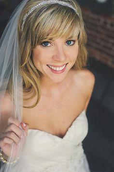 natural makeup and side swept bangs http://www.weddingchicks.com/2013/11/26/gold-and-gray-wedding/
