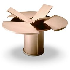 Expanding/extending circular dining table. Not cheap, but very clever.