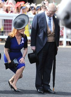 Dropping down: Sarah Ferguson, the former Duchess of York, sweeps the Queen a low curtsey while ex-husband Prince Andrew bows