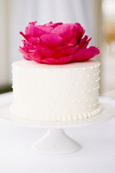 Simple white cake adorned with a fuschia peony | Utterly Romantic Berry and Greyed Jade Wedding Inspiration