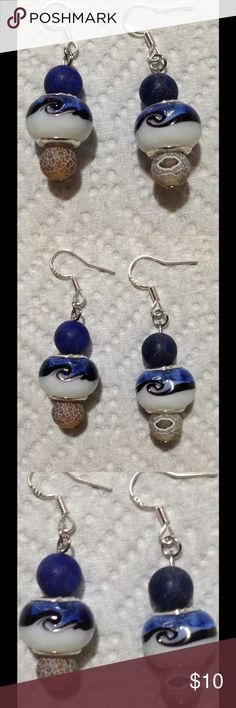 Blue and White Lampwork Glass Earrings These unique earrings are made with frosted coffee Agate, lapis lazuli, and blue and White swirled lampwork beads. The hooks are sterling silver. These earrings and all PeaceFrog jewelry items are made by me! PeaceFrog Jewelry Earrings