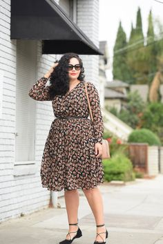 Tanesha Awasthi, also known as Girl with Curves, wearing a long sleeve plus size…