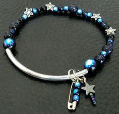 Another one of our ever-popular Spacey Bracelets! This galaxy bracelet is 7 inches. Silver, glass, and sparkly blue goldstone beads.  Proceeds benefit EarthJustice:  This bracelet is made with round, natural stone beads and coconut shell spacers. It has a a burnished copper-tone tree to remind us that all life is sacred, and we must fight to preserve our wild places for future generations.  Proceeds benefit EarthJustice.  www.earthjustice.org  Today's environmental challenges are greater…