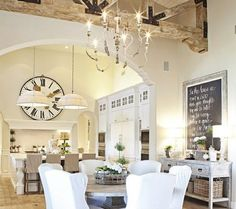 kitchen/dining space - farmhouse/vintage design, beams, lg clock, dbl pendants, arch, zinc table and slipped seating