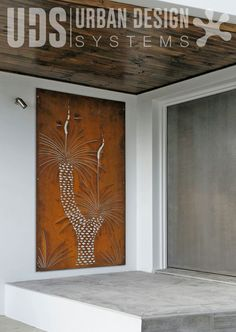 Decorative screening - Grass tree. Our new Grass tree design makes such a statement at the entrance of this stylish, modern residential property with the rusted weathering steel holding it's own against the other heavy weight industrial materials of concrete, steel and hardwood timber used in the building's construction.