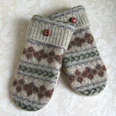 These warm, casual mittens were made from felted, recycled wool sweaters. The front of the mittens have a fair isle pattern of brown, with blue and