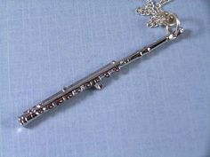 Flute Necklace silver long Instrument Music by miniblings on Etsy  I have one of these!