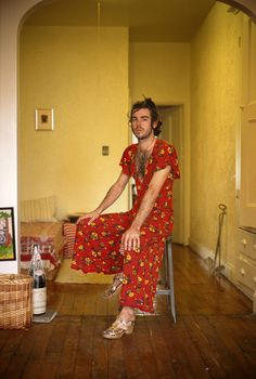 Portrait Series of Men Posing in Their Girlfriends' Clothes