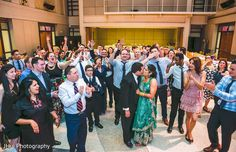 Indian newlyweds surrounded by friends and family. http://www.maharaniweddings.com/gallery/photo/139470