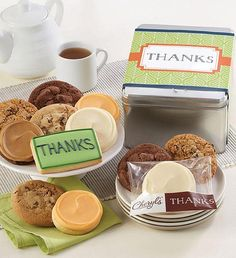 This delightful gift tin is filled with a delicious assortment of chocolate chip, oatmeal raisin, chocolate chocolate chip, buttercream frosted orange citrus and mocha latte cookies along with our thank you wrapped buttercream frosted vanilla cut-out cookies and a hand decorated crunchy thank you sugar cookie. Thank You Cookies, Cut Out Cookies, Cookie Frosting, Buttercream Frosting, Orange Frosting, Box Brownies, Tin Gifts, Party In A Box