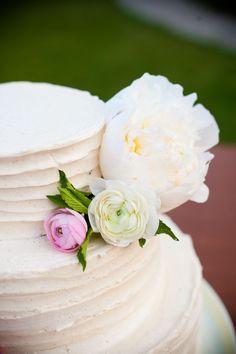 vanilla bean wedding cake decorated with peonies