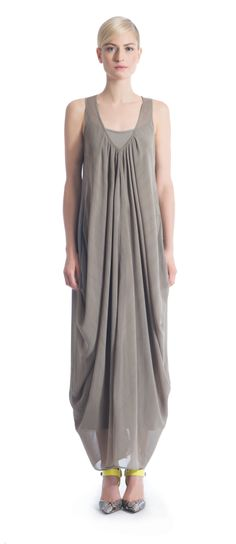 The Caroline dress has the perfect balance between elegance and comfort. This effortlessly chic design is generously draped from front to back with gentle pleats at the deap V neckline. The breezy chiffon fabric is lined with a viscose jersey full length slip for a delicate feel without being sheer. Available in Khaki and Black. http://ronenchen.com/us/dresses/caroline-chiffon-dress.html