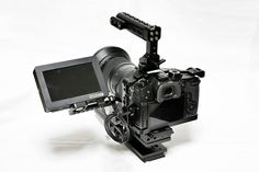 SmallRig Cage for Panasonic Lumix 2049 is designed specifically for Panasonic Lumix It does not block any access to the SD card slot, battery compartment, and all camera controls. Camera Rig, Camera Tripod, Camera Gear, Cinema Camera, Film Camera, Diy Shops, Thing 1, Cool Backpacks, Grand Theft Auto