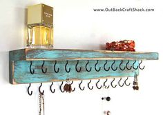 And if you need more space for your glittery treasures, this distressed wood jewelry holder with simple hooks should solve that.