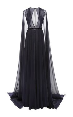 This **Naeem Khan** gown features a plunging V-neck and sheer floor-length cape attachment.