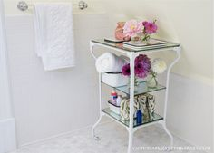 Wow! White paint & new shelving upcycles an old medical table from dingy to dainty.
