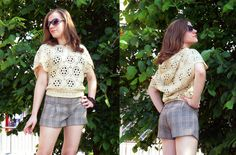 Cream crochet vest / shirt with a hood.