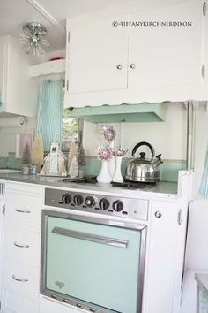 Vintage Oven and Range in Robin's Egg Blue in a CAMPER. LOVE IT. I would camp incessantly! by kathie.camechis