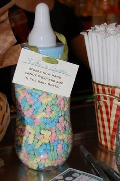 guess how many pacifiers Smarties are in the over sized baby bottle - baby shower games #babygame #babyshower #itsaboy