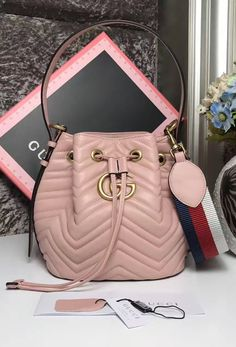 The new Marmont Quilted Leather Bucket Bag