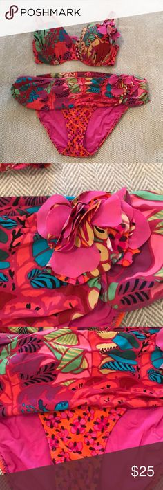 Nanette Lepore Tropical Bikini Size M Seriously one of my fave bikinis ever. Such fun colors and details. Material is in great condition, but has faded a bit. So much life left in this suit! Adjustable/removable  straps. Top was altered- darts have been removed. Slightly visible from interior of cups, but not when wearing. *pictured Nanette Lepore Swim Bikinis