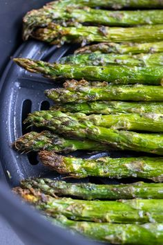In less than 10 minutes you can have this ultra crispy Air Fryer Asparagus Recipeready and on your dinner table! Simply toss asparagus spears in a bit of oil, with salt and pepper and then air fry for just a few short minutes. This quick and easy side dish recipe is also low-carb, keto, vegan, Whole30, and Paleo! #airfryer #asparagus #vegan #lowcarb Healthy Side Dishes, Side Dishes Easy, Vegetable Side Dishes, Side Dish Recipes, Vegetable Recipes, Best Gluten Free Recipes, Whole 30 Recipes, Paleo Recipes, Asparagus Recipe