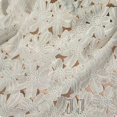 White Lace Fabric, Wedding Gown Lace Fabric, Appparel Fabrci Supplies,Retro Hollowed Bridal Wedding Dress Fabric. $33.00, via Etsy.