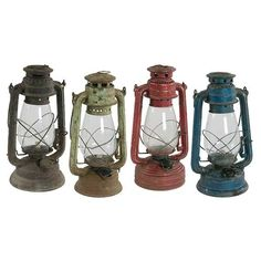 Vintage Oil Lanterns in assorted colors by Jaipur Home. Each piece is one of a kind and no two pieces are exactly the same.